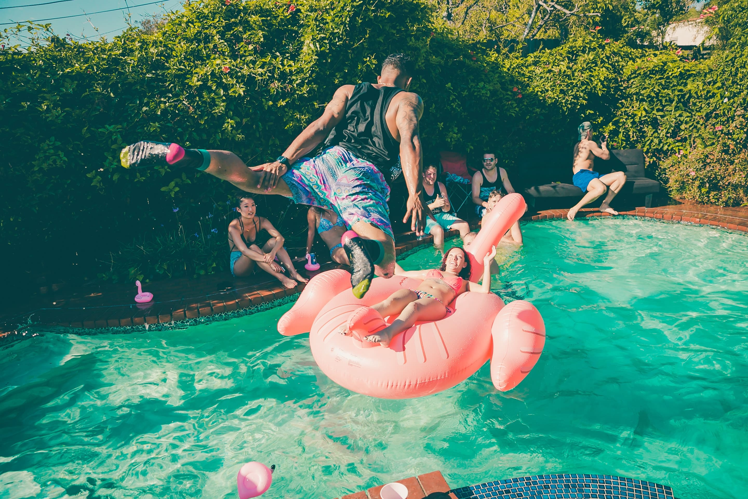 a group of friends making party in a beautiful pool