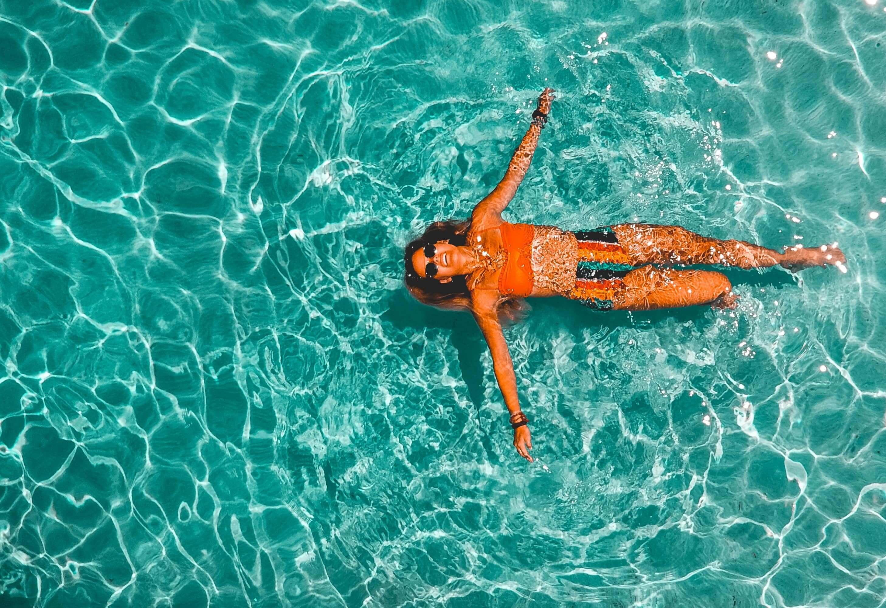 A woman swimming in clean and fresh pool
