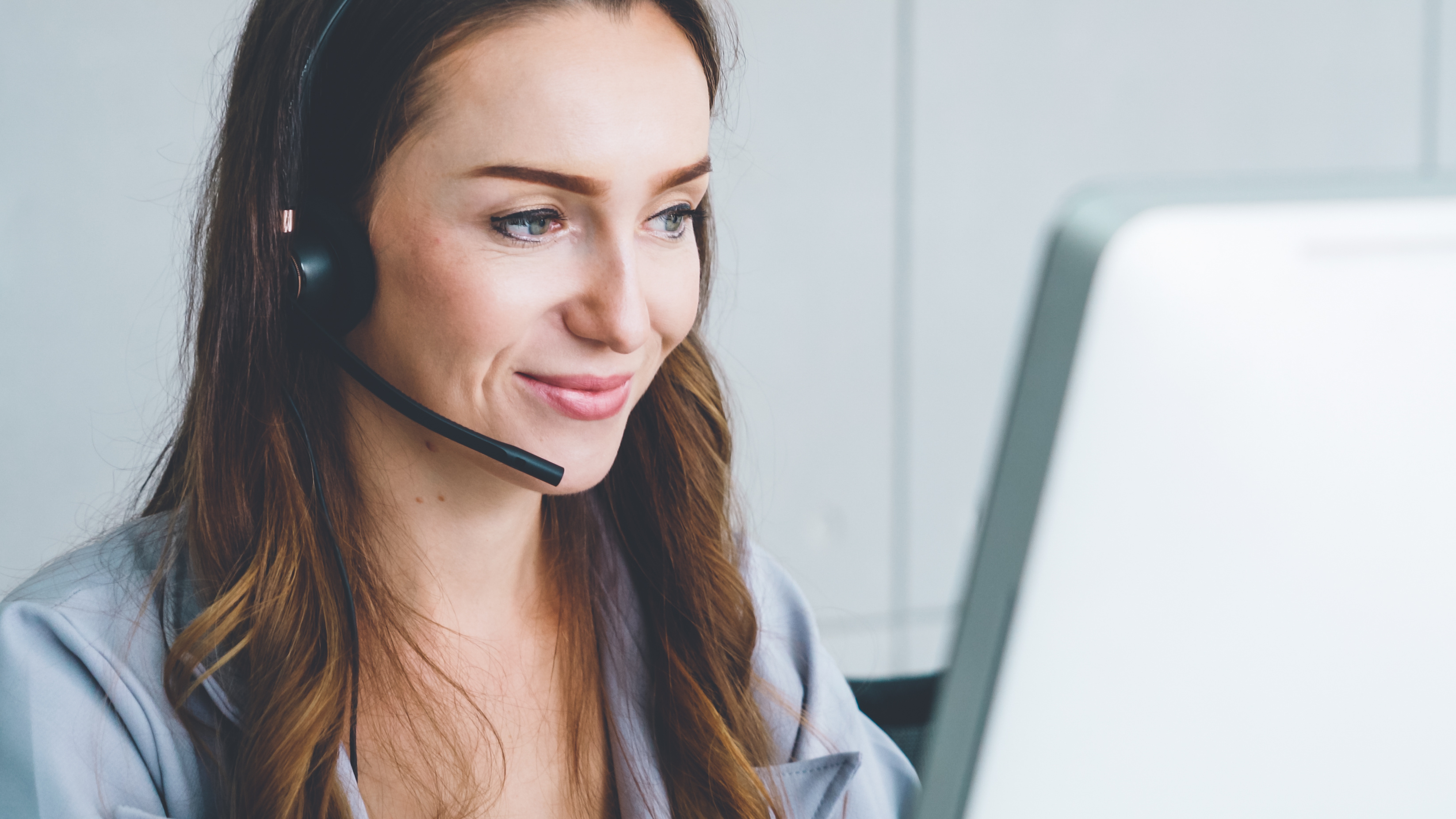 Lady with headset answering customer call