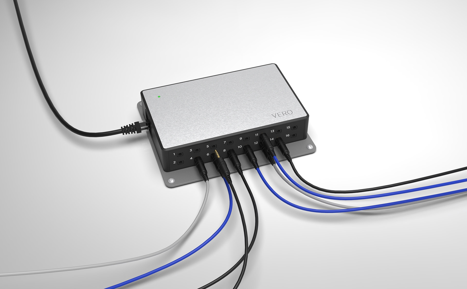 VERO Beverage Management Hardware on a light grey background, with several wires plugged into its front chassis.