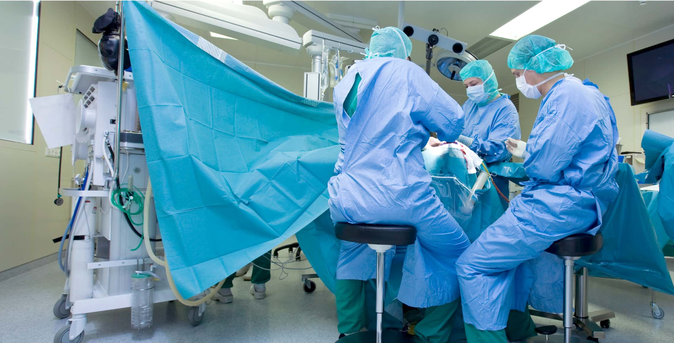 Image of three surgeons performing a surgery.