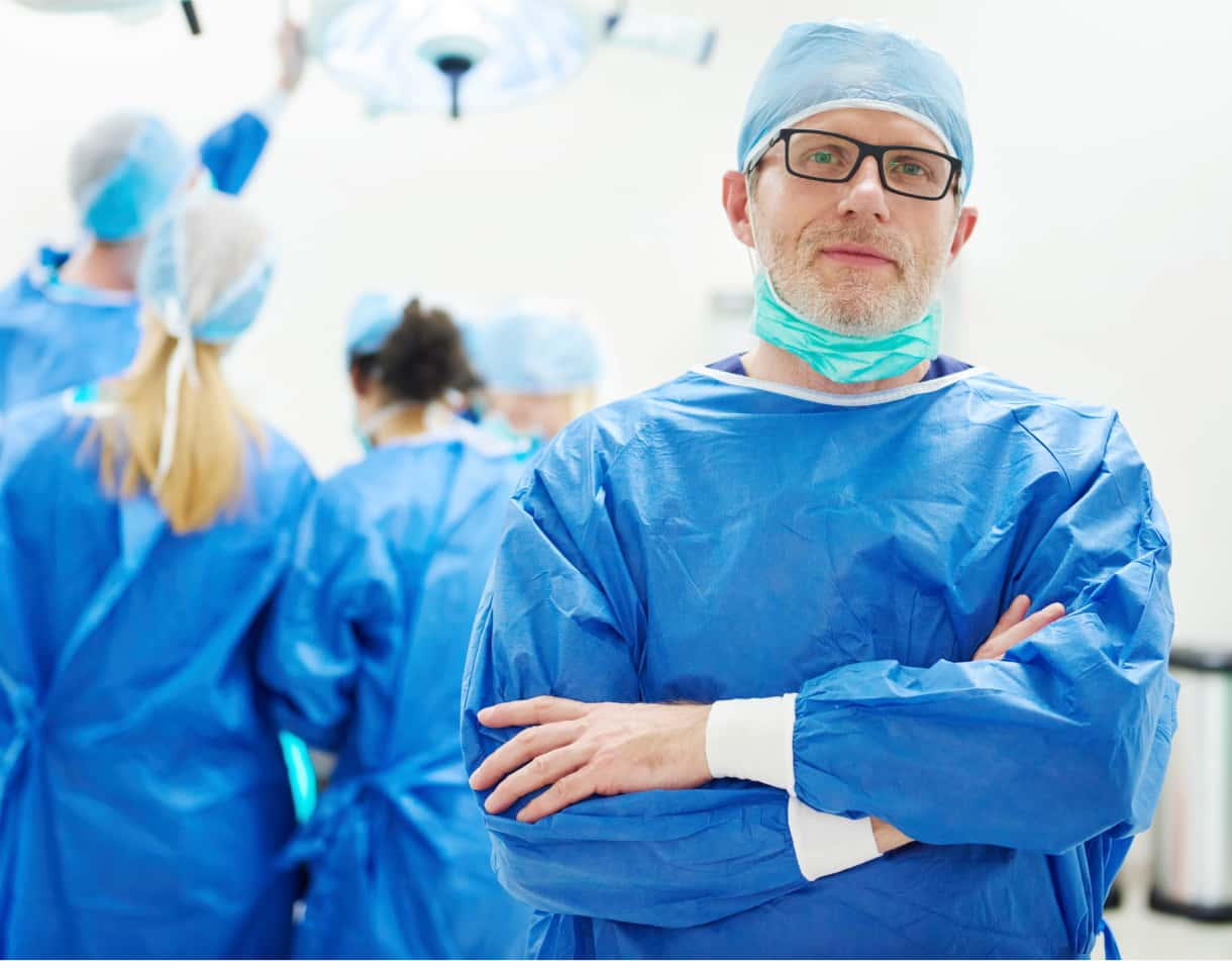 Heroic photo of smiling male surgeon in OR.