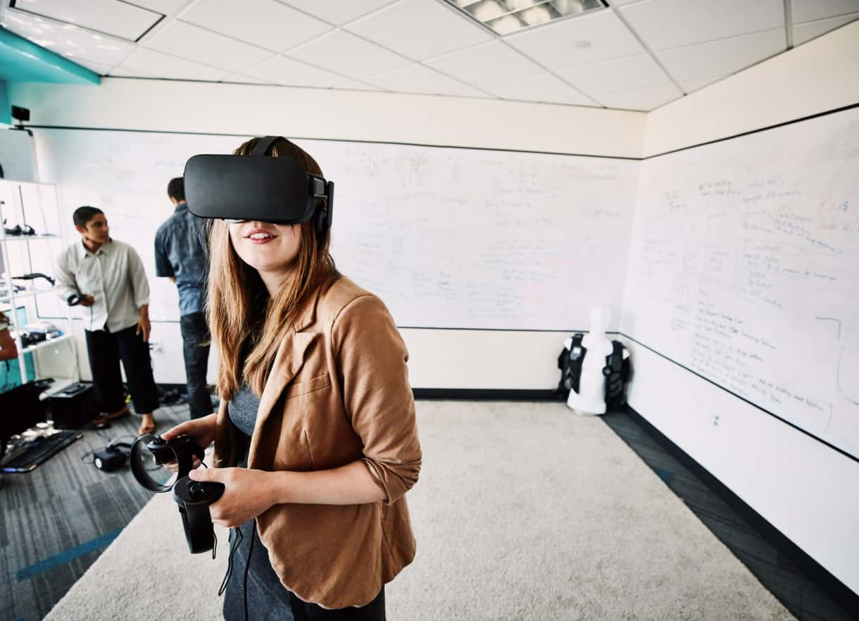 Female Osso user wearing a VR headset.