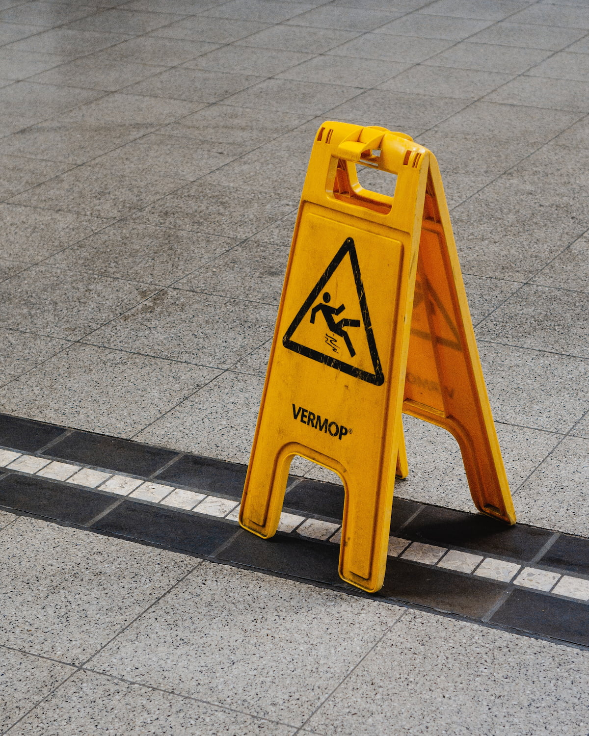 Yellow slippery when wet sign