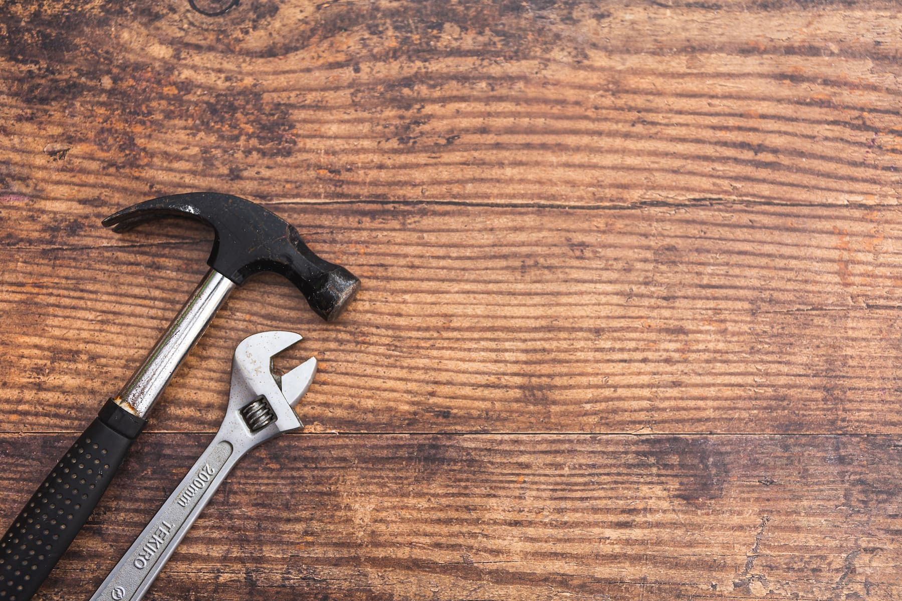 Hammer and wrench on a table