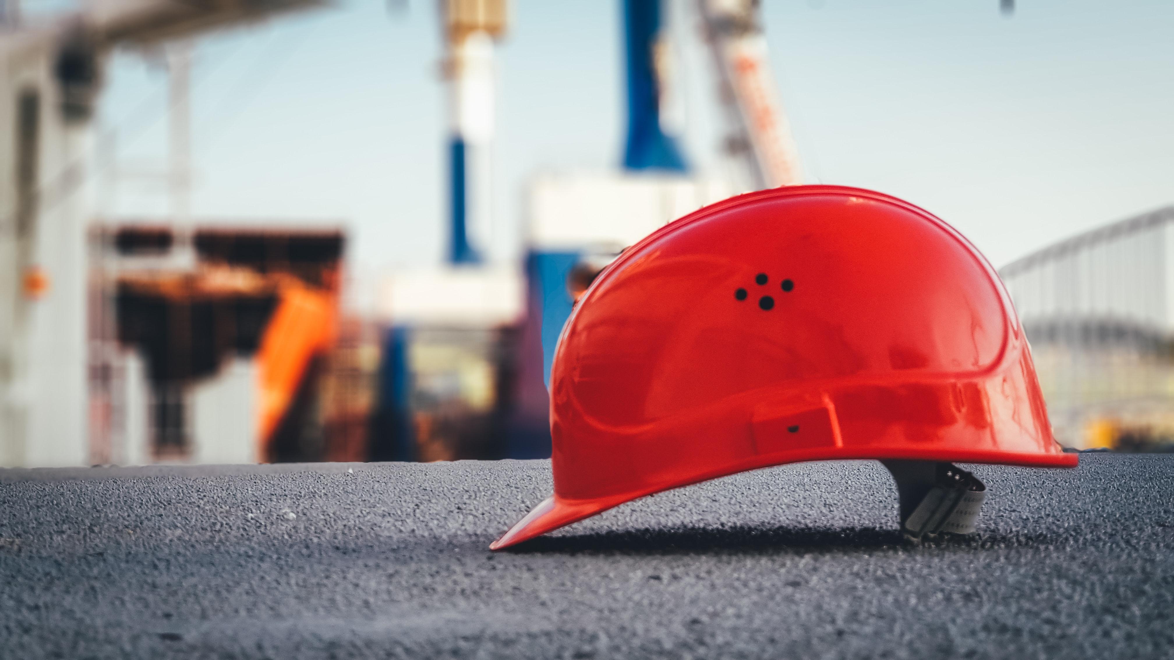 Hardhat on concrete at construction site