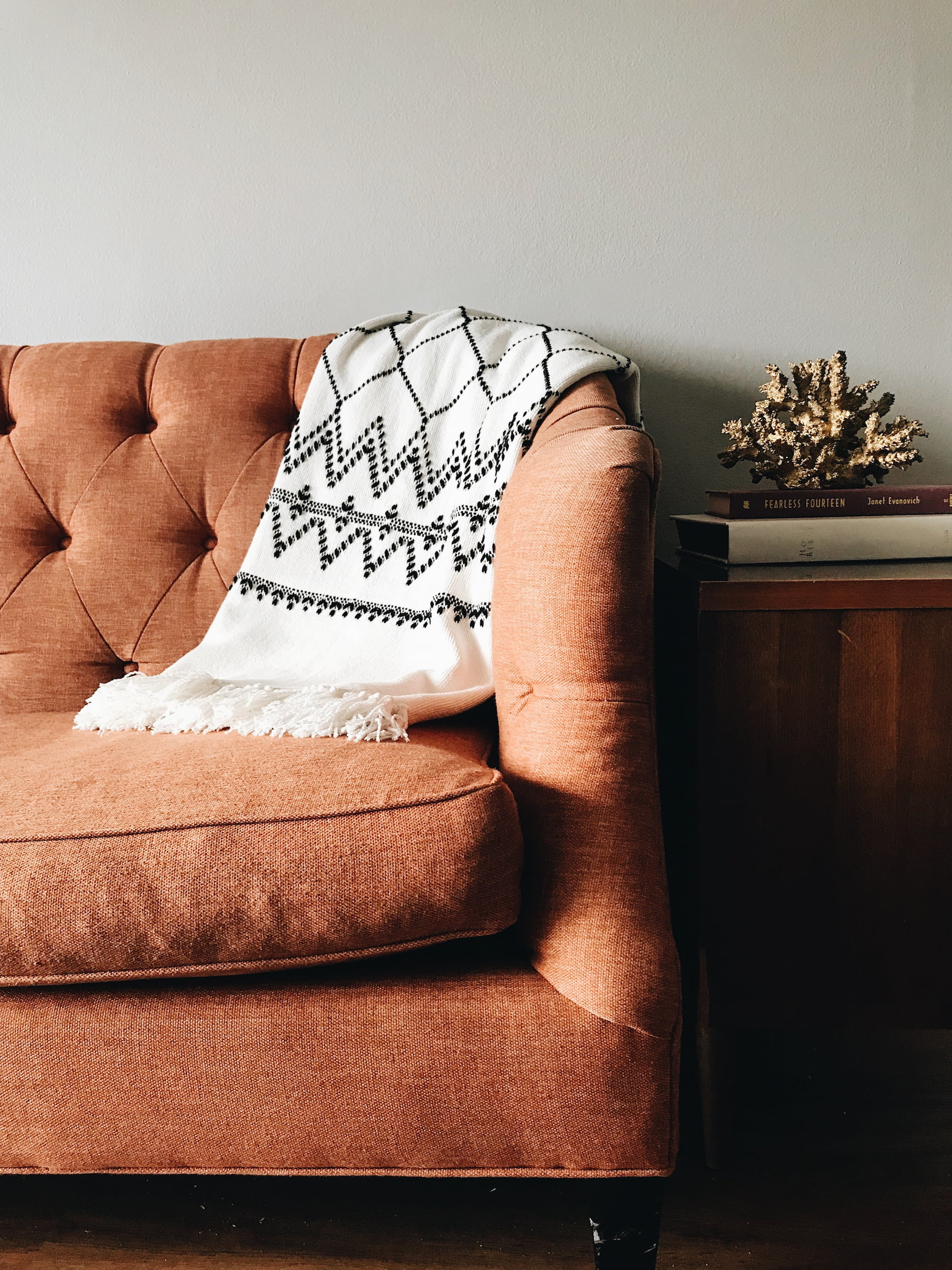 Sofa with blanket and table