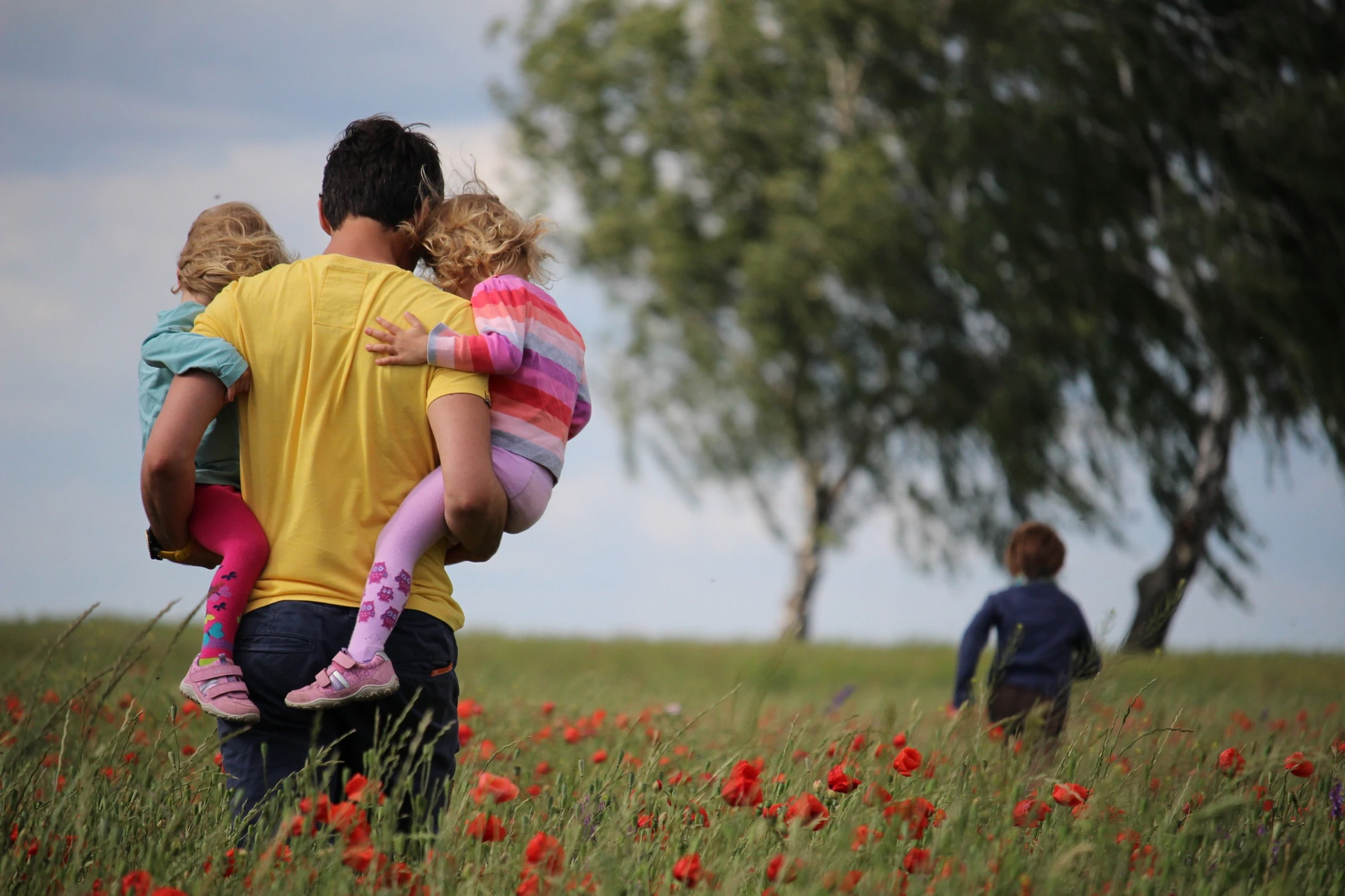 Estate planning father with children in field