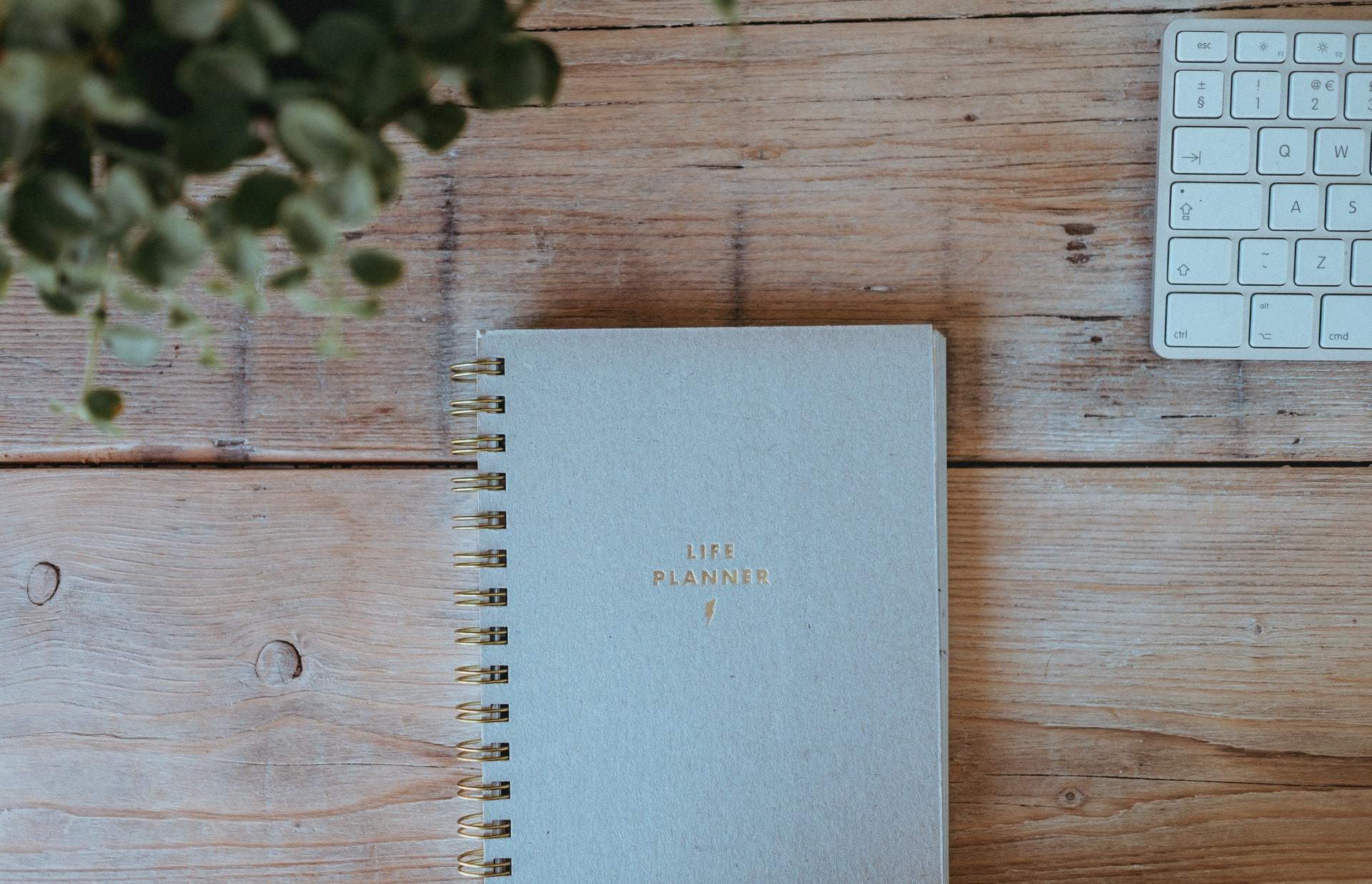 Life planner notebook on desk