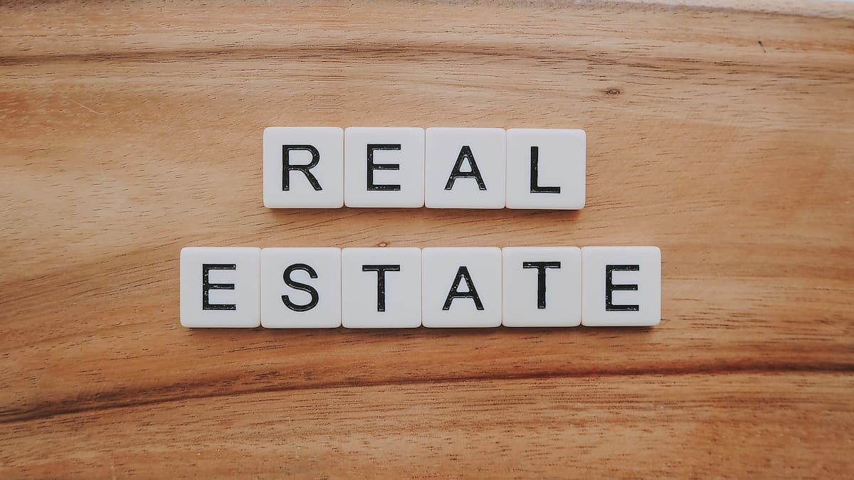 Tiled letters spelling out Real Estate