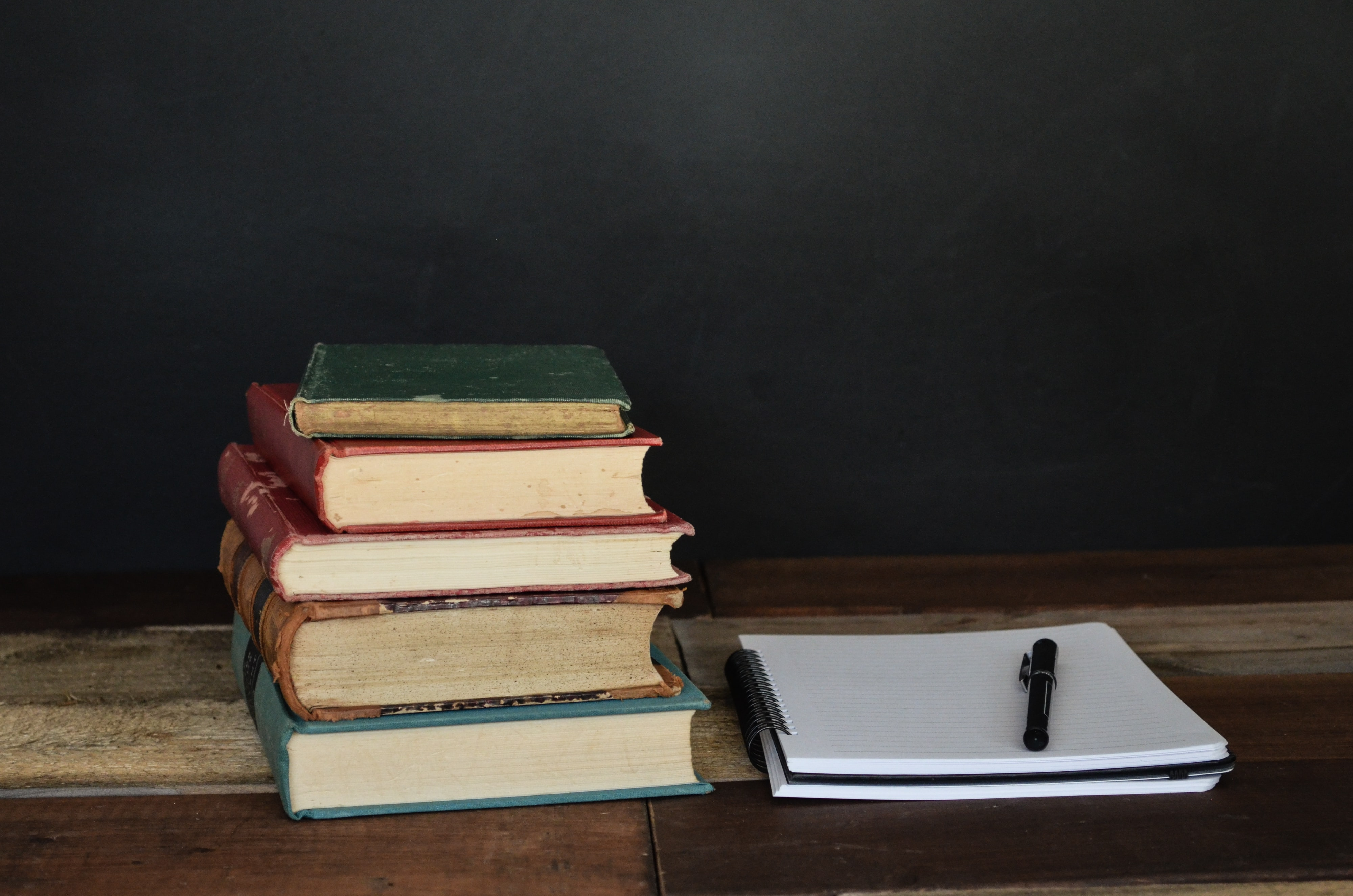 Law books and notepad with pen