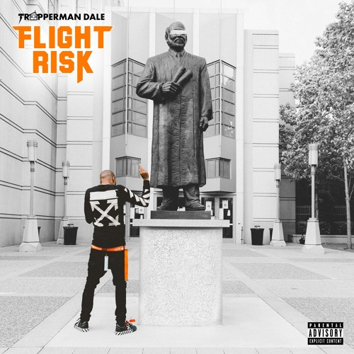 A man stands in front of a large statue in a white washed, plain looking area. The title of the track is in orange as well as the belt on the man. The cover art for Mary Jane.