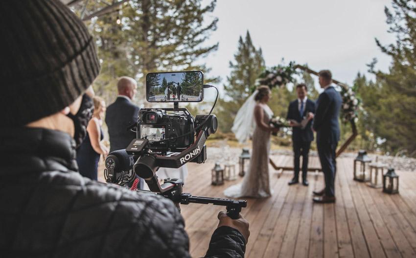 wedding videographer live streaming a ceremony