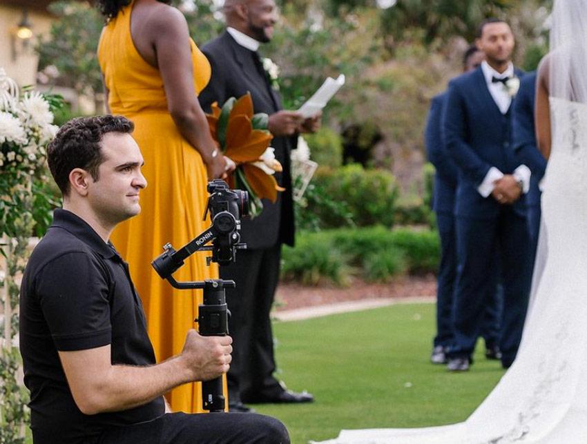 wedding videographer recording an event
