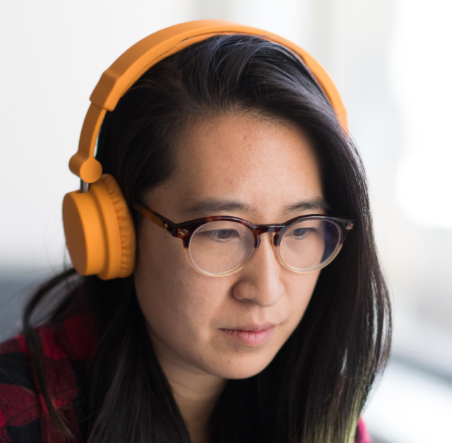 A young female employee with her headphones