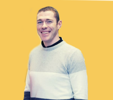 A professional headshot of Ken Doherty, Co-founder & COO of Cerebreon technologies on a yellow background.