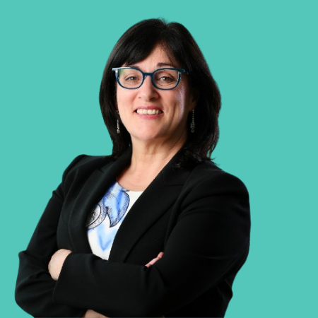 A professional shot of Anne Heraty, CEO of the CPL group on a green background