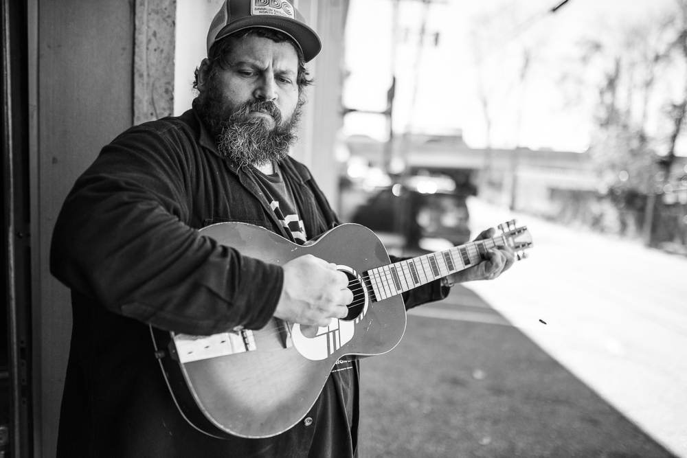 Just a man and his guitar. Aaron Draplin in Denver. Photo by Mike Arzt