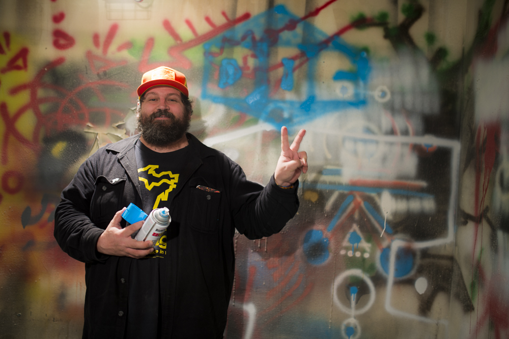 Aaron Draplin tagging his logo at The Public Works, photo by Mike Arzt