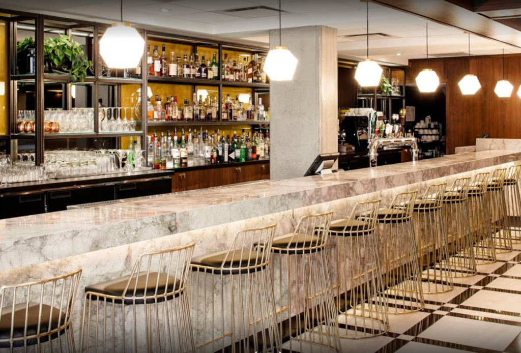 Maggie Oakes Montreal marble bar with golden stools