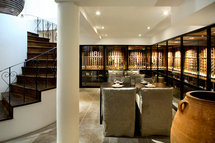 dining space by cellar in Milos Restaurant Montreal