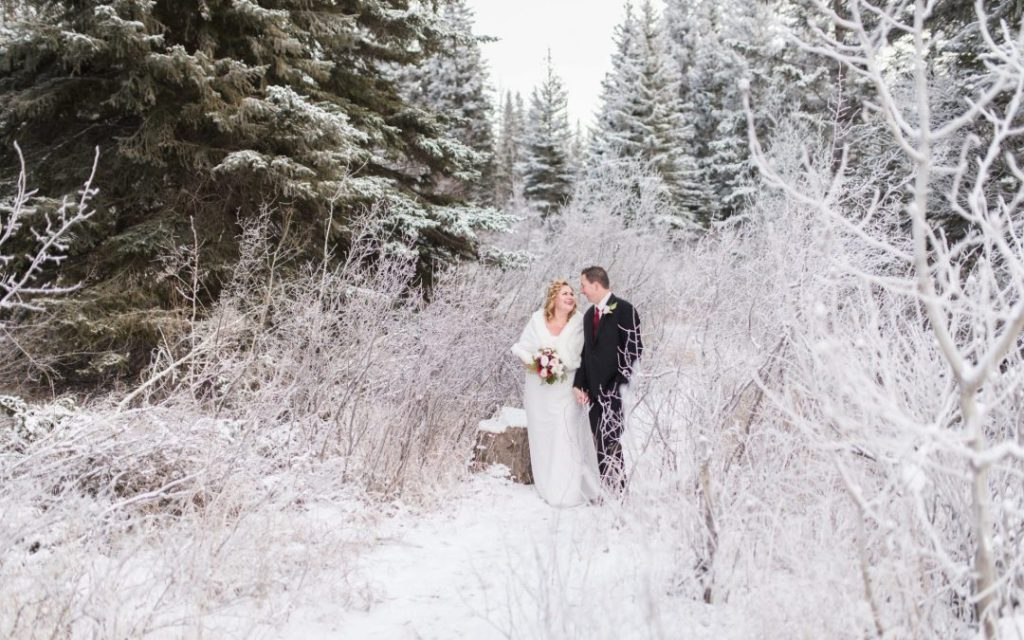 newlywed photo ops in winter forest setting