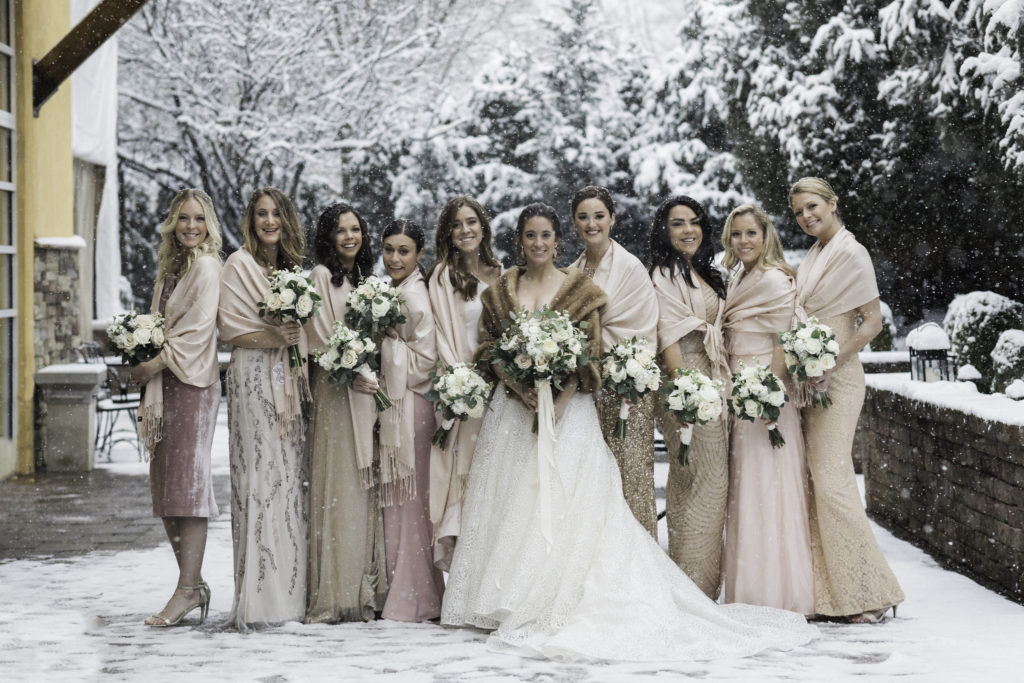 bridesmaid and bride in winter photoshoot