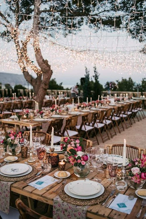 tuscan style ourdoor wedding reception at sunset