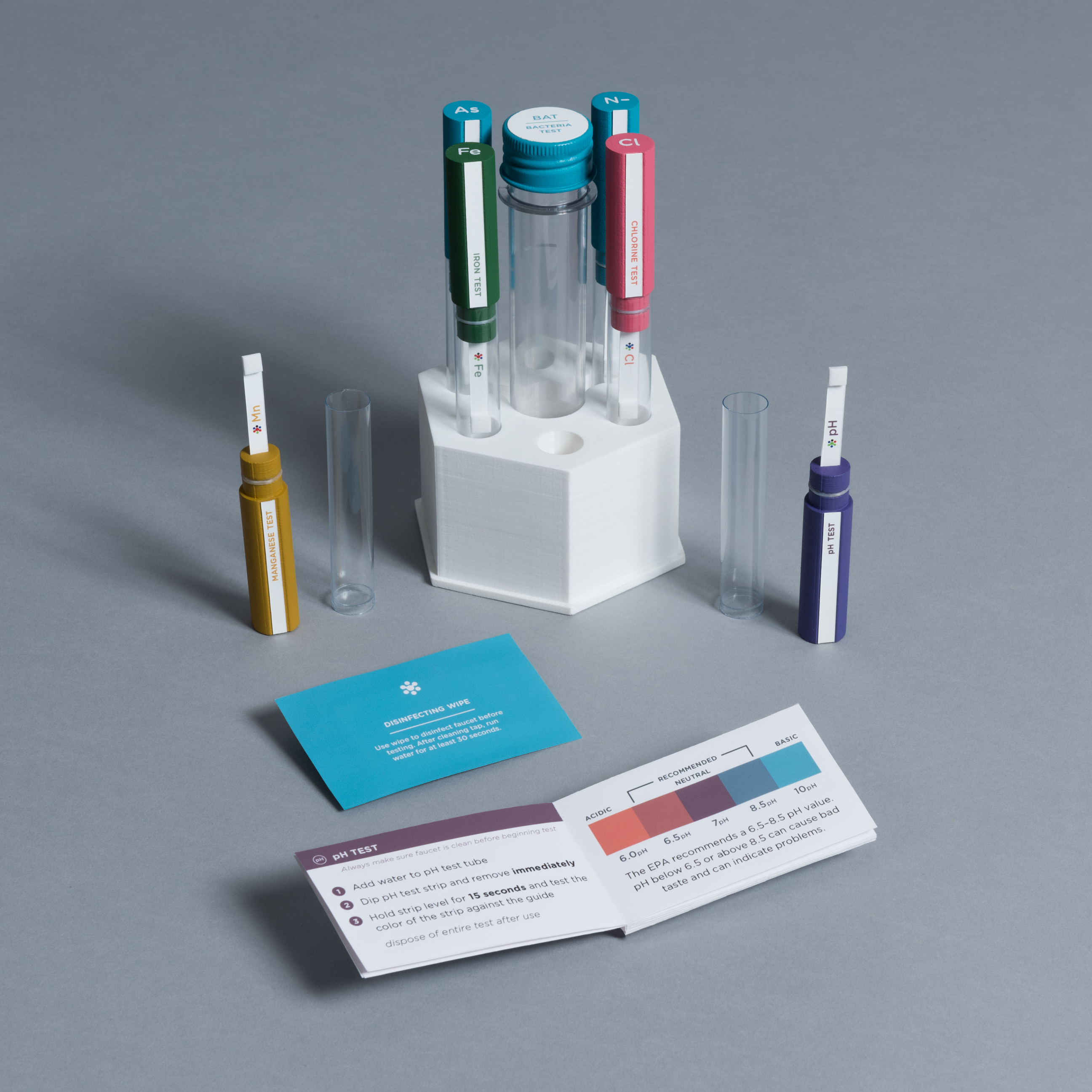 A set of test tubes and a hexagonal case with a small open booklet