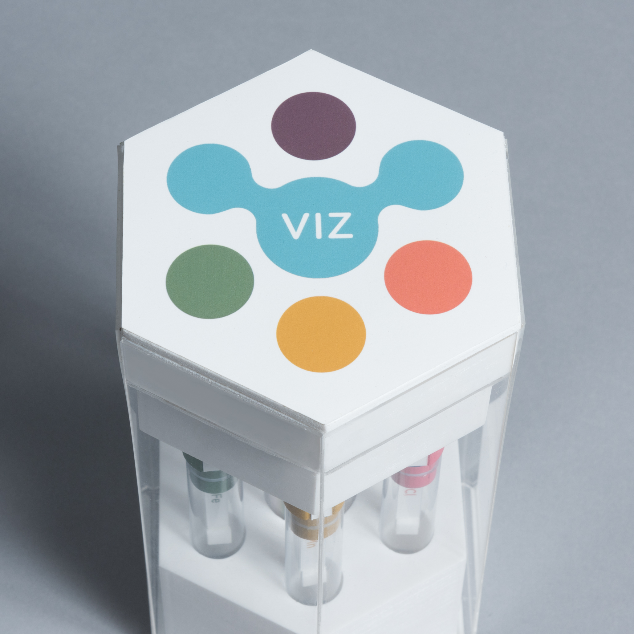 """Lid of a hexagonal package with a logo on top saying """"VIZ"""""""