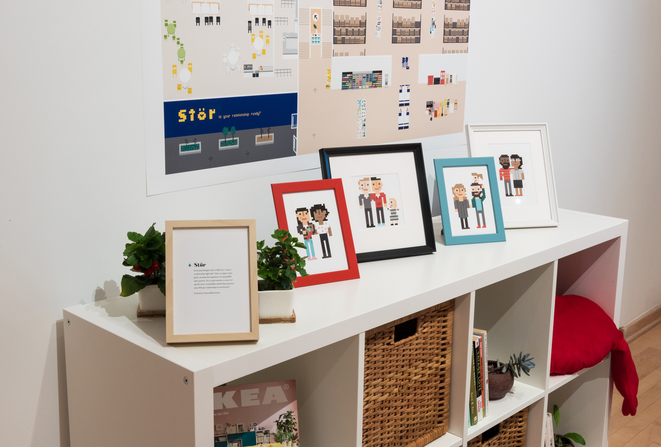 A series of picture frames on an IKEA shelf