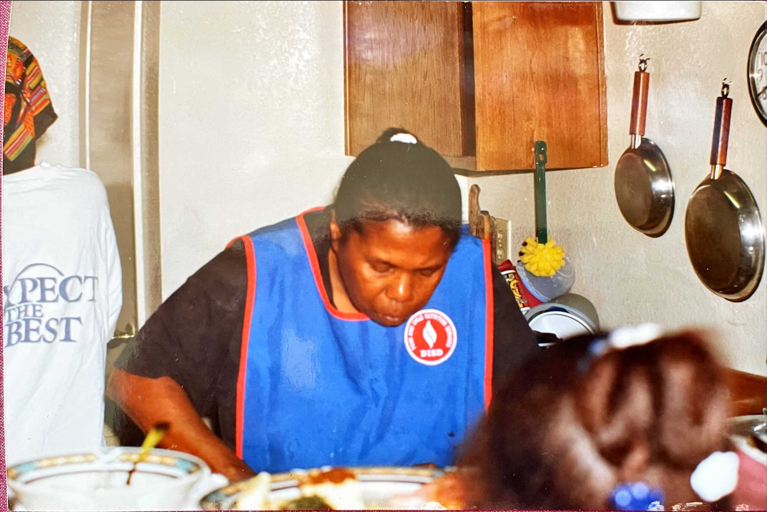 Jessica Mason's grandmother cooking a meal in the kitchen