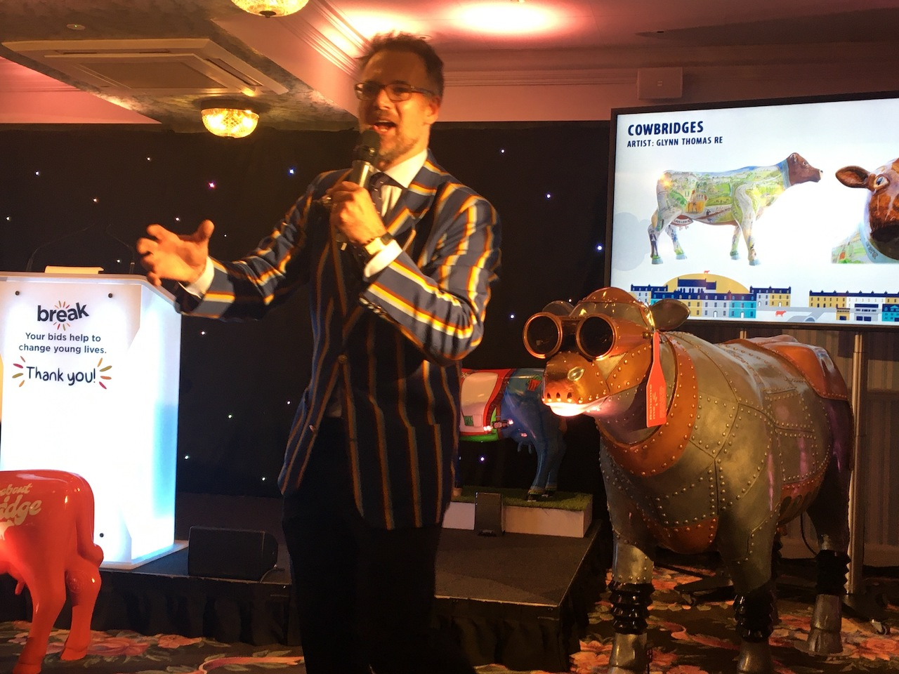 Charles Hanson in charge at the auction, with Moo Moo Tron III behind him