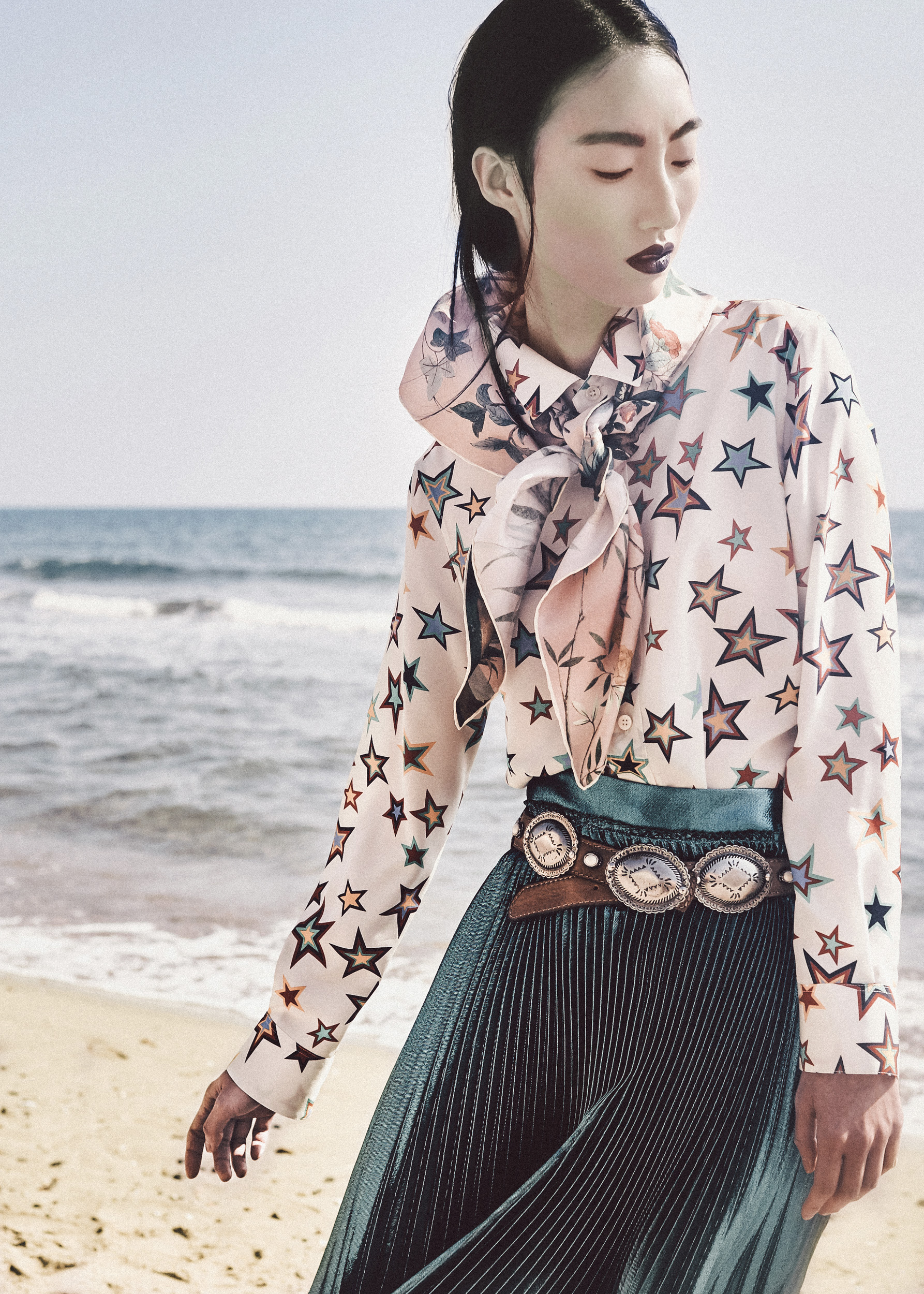 asian model at the sea photographed by gai stefano for a fashion editorial