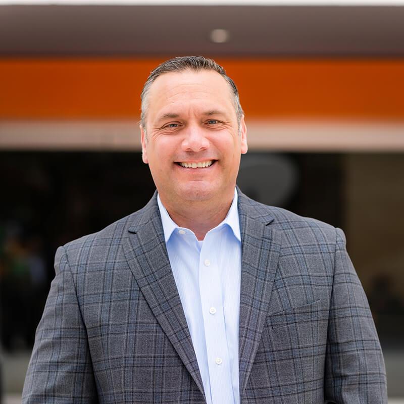 Portrait of Leadership team member Charles Elliott, President of Vxtra Health