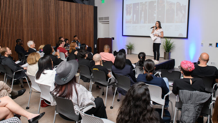 Daniela Golborne of ICA Accelerator company Progeny Coffee pitching at a pitch event in 2019. Click the images for more photos.