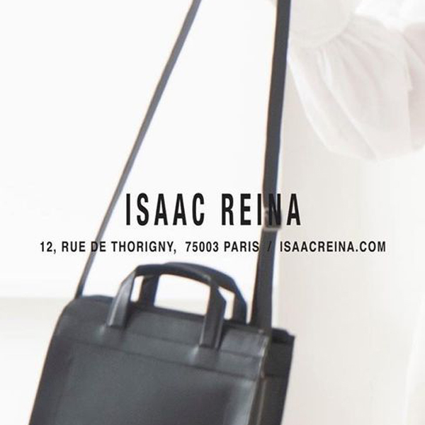 Isaac Reina logo overlaid on image of handbag