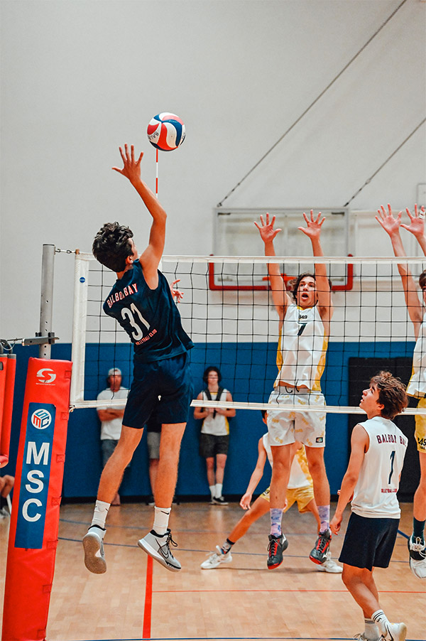 Close up of a volleyball player going for a spike