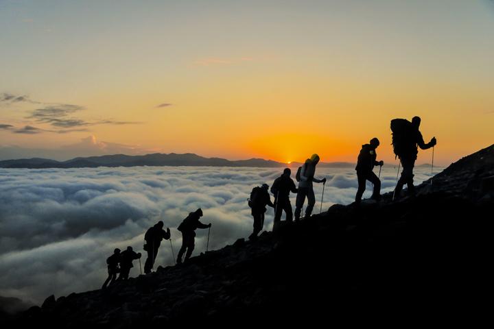 A team climbing a mountain