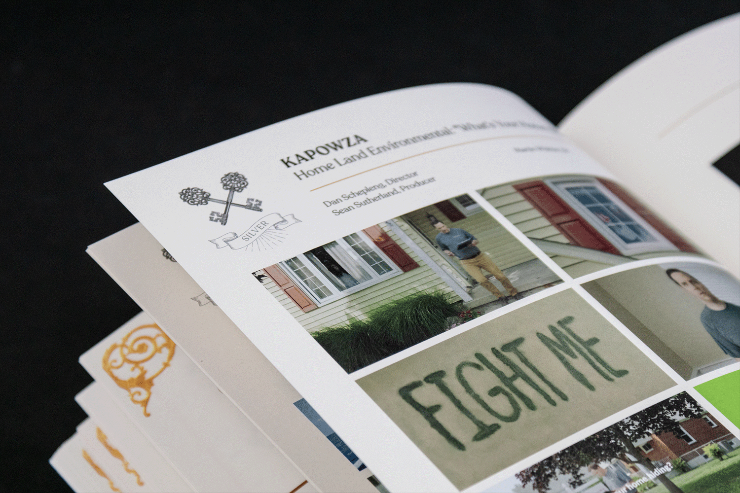 Photograph of a book open to a page that shows a silver award winner.