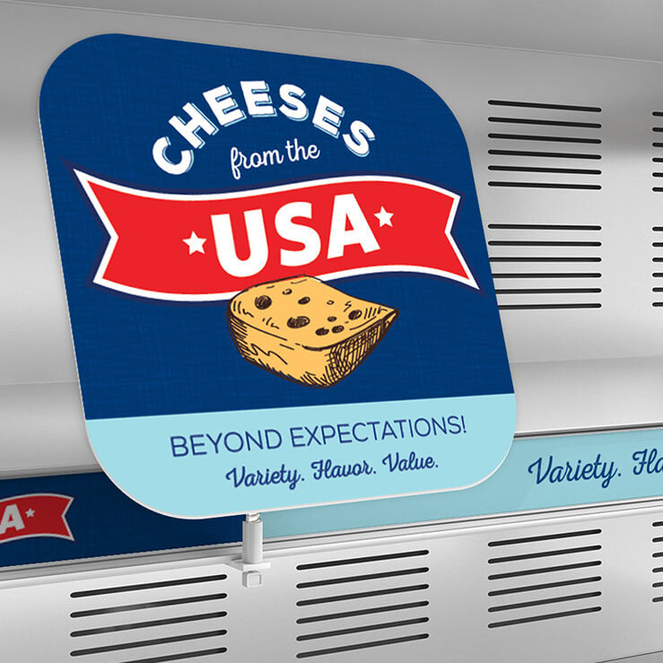 """Image of a sign that reads """"Cheeses from the USA""""."""