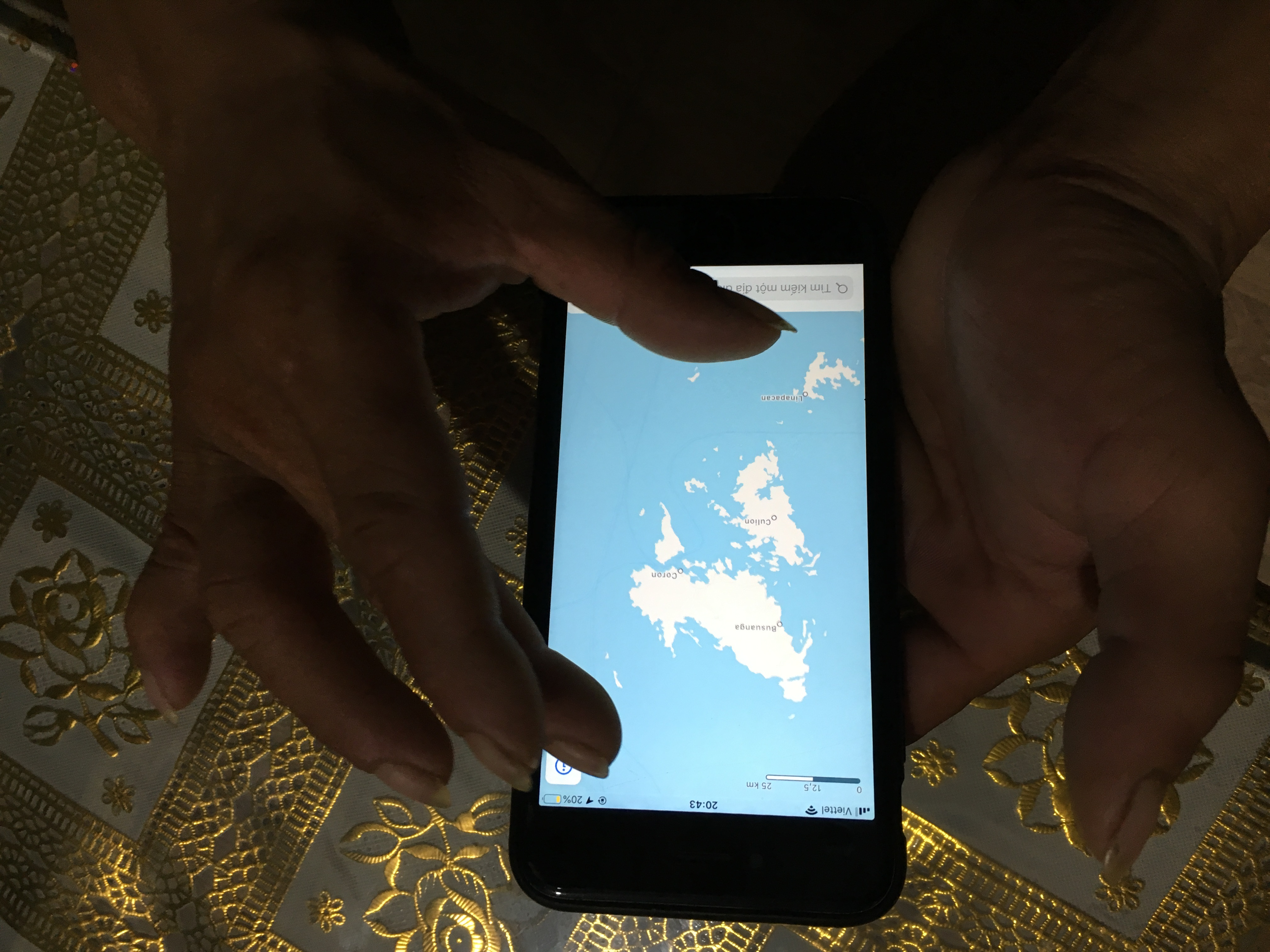 Duy opens the google map on his phone to introduce the waters he had fished in South China Sea, Photo / Vo Kieu Bao Uyen