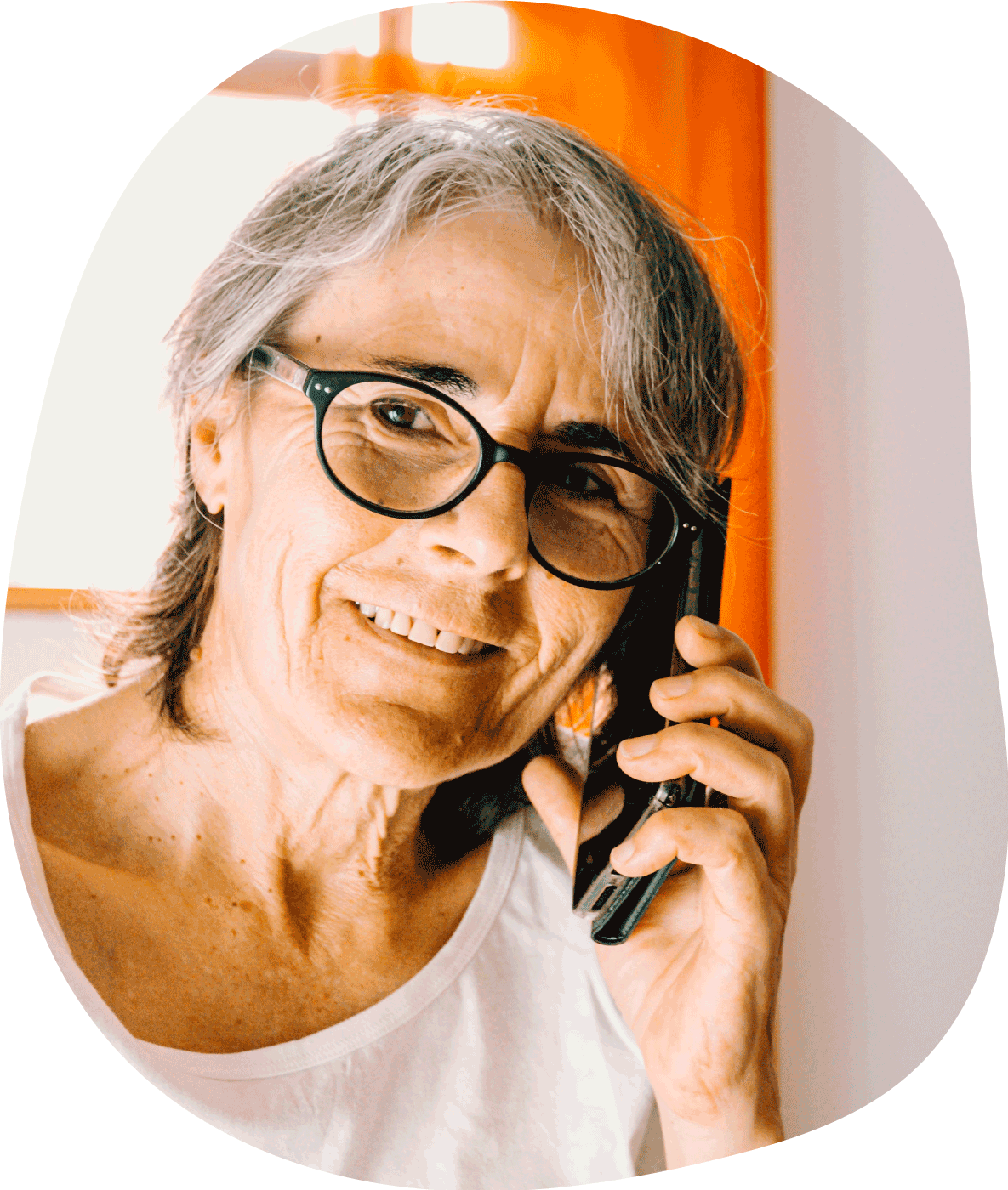 Photograph of older woman doing a telehealth consult on the phone