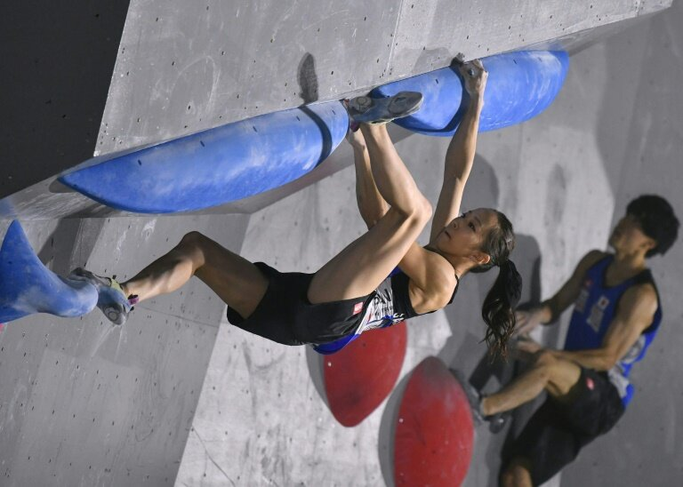 Rock Climbing Competor Showing Flexibility and Mobility