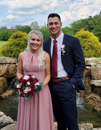 Campus Pastors Mark and Abigail Griffith Smiling at a wedding