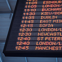 An electronic departure board showing the departure times for airplanes to different destinations.