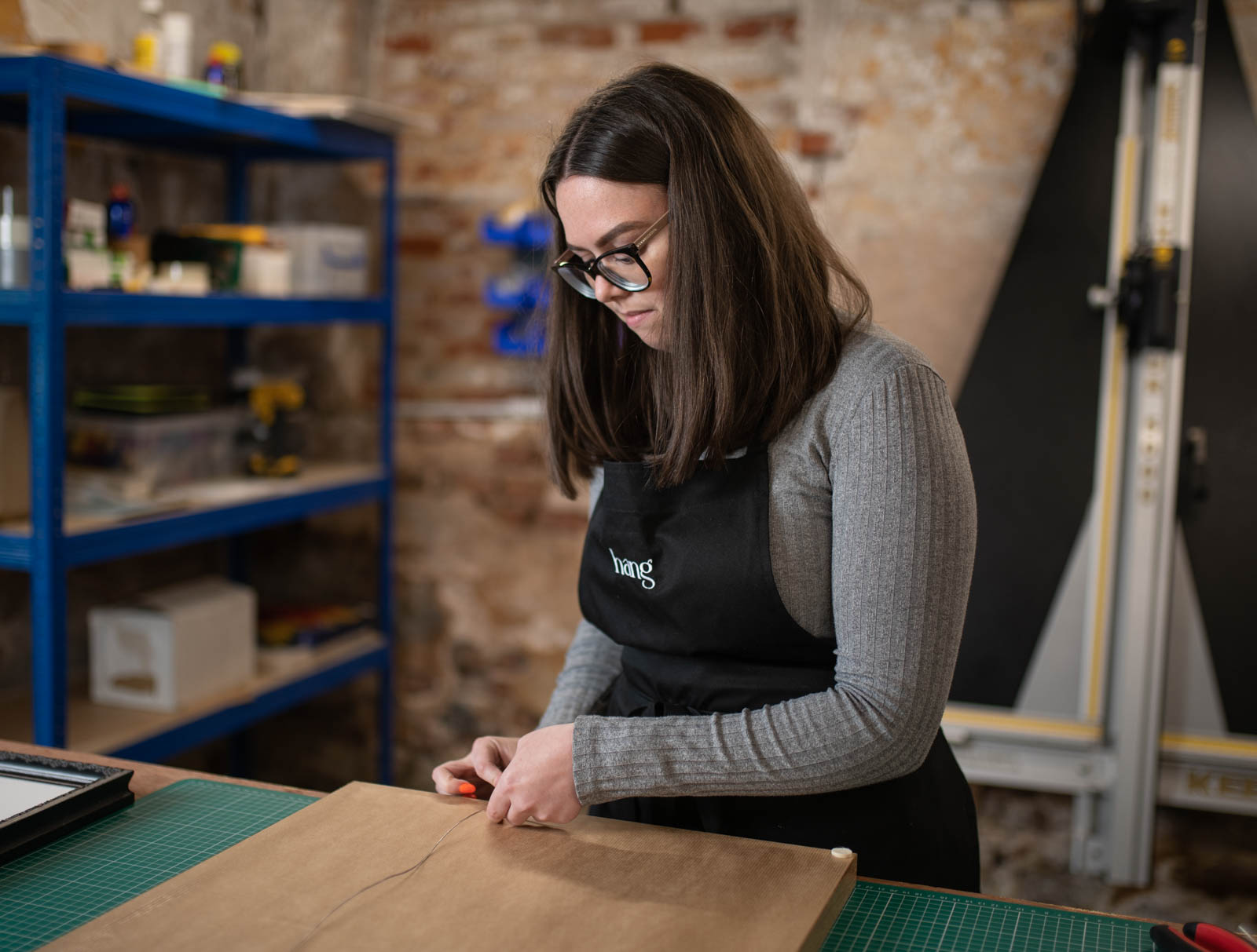 local picture framer making a frame.