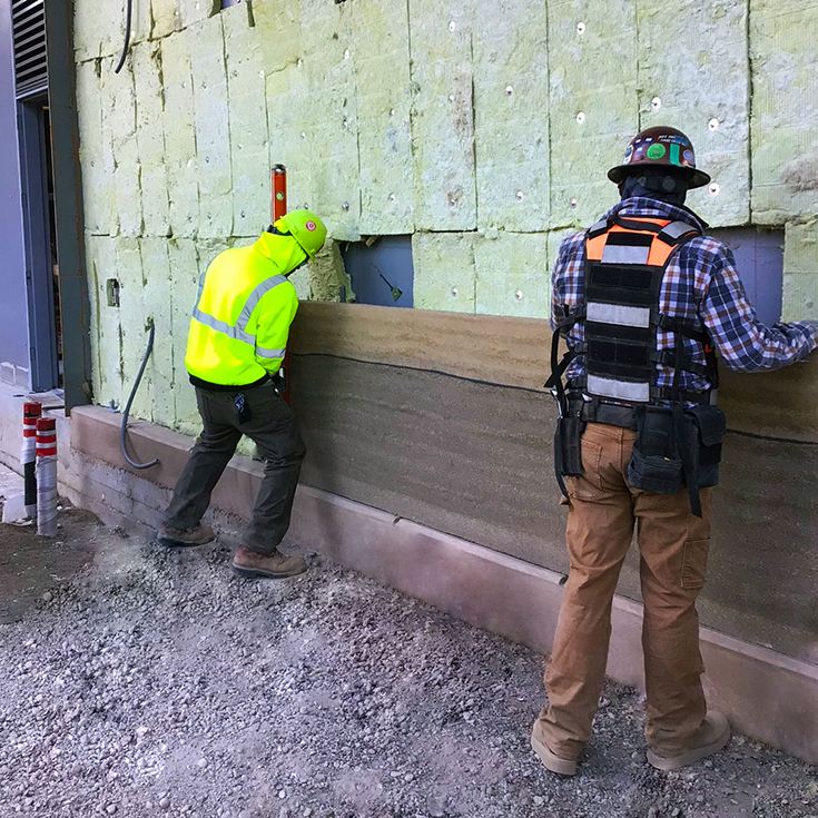 Workers installing a Specialty Construction project