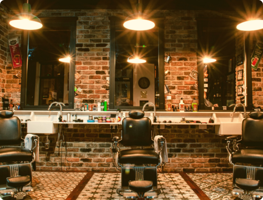 A photo of empty barber shop chairs