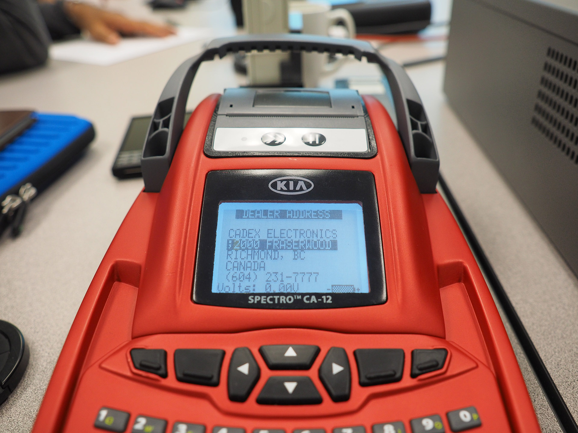 A prototype of the device in red, with a working screen.